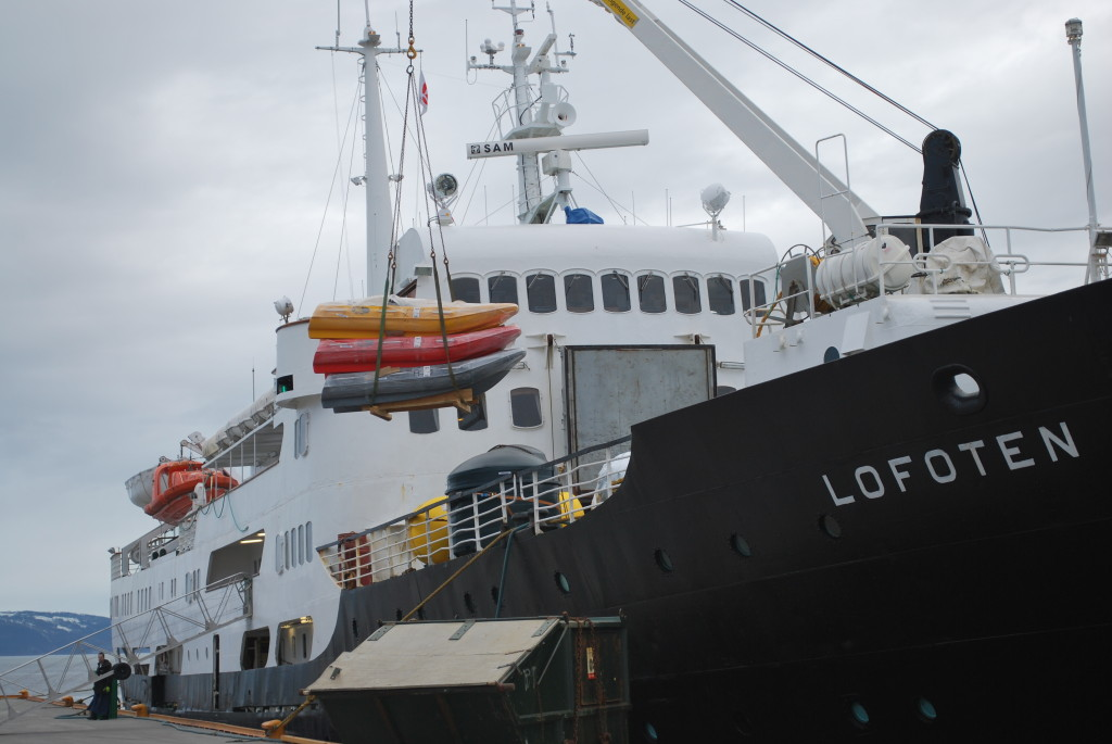 Lofoten is a working ship with all cargo crane-loaded in and out of the hold. * Photo: Ted Scull