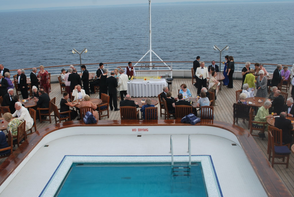 Gathering for pre-dinner drinks on the afterdeck. * Photo: Ted Scull