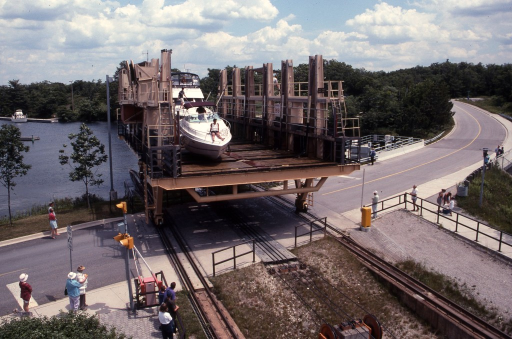 Ontario's Big Chute marine railway carries a private yacht between an arm of Lake Huron and over a road to Ontario's inland waterways. * Photo: Ted Scull
