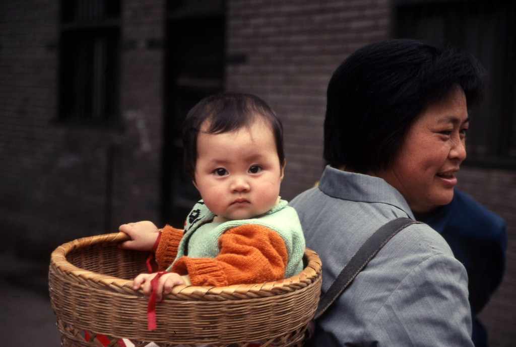 Mother and child pass during a village stop along the Yangtze.