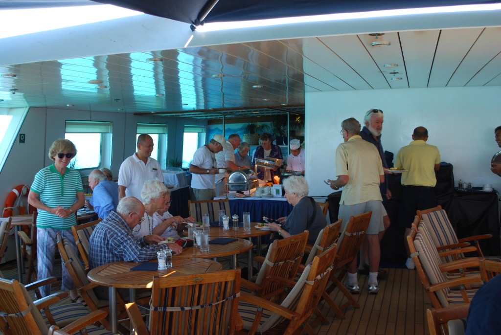 Orion: Lunchtime on deck. * Photo: Ted Scull