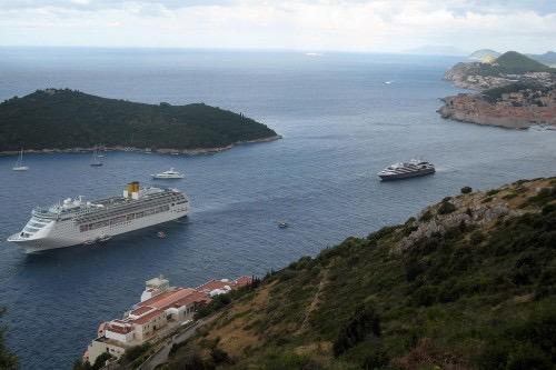 Ponant's mini cruise ships are dwarfed by the giants. * Photo: Heidi Sarna