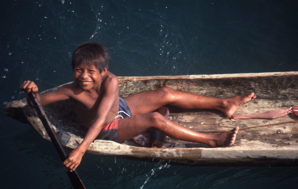 A Cuna boy from the San Blas Islands, Panama comes among side. * Photo: Ted Scull